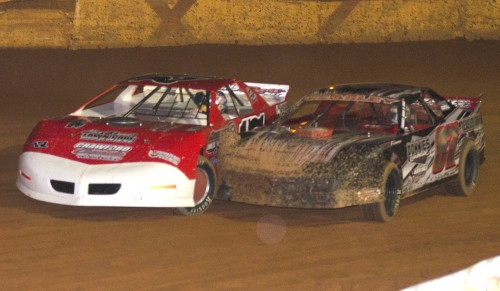 Chris Jones (17) and John Teasley (87) battle on the opening lap of the Modified Street feature during last Saturday's action at Hartwell Speedway in Hartwell, GA.  Racing action from the 3/8 mile track is highlighted on this week's Raceweek Illustrated Garage Talk program. Chris Jones would go on to score the win. Photo by Heather Rhoades