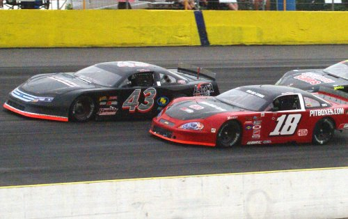 Justin South (43) leads Hunter Robbins (18) during Saturday night's JEGS 100 Pro Late Model feature at Gresham Motorsports Park.  South would go on to score the win, with Robbins in second.  This week's Raceweek Illustrated Garage Talk features coverage from Gresham, along with action from Anderson Motor Speedway and Montgomery Motor Speedway.  This week's episode is now available to view online.  Photo by T. Spackman