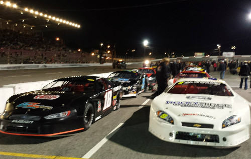 Chase Elliott (9) and Hunter Robbins (18) made up the front row for Saturday night's All American 400 at Fairgrounds Speedway Nashville.   Photo by Matt Weaver