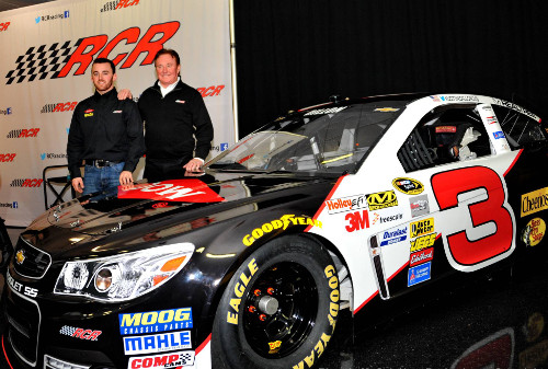Austin Dillon (left) and his grandfather, Richard Childress (right), announced Wednesday that Dillon will pilot the iconic No. 3 in the Sprint Cup Series beginning in 2014.  Photo by Rhonda McCole