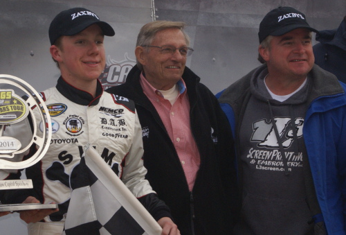 John Hunter Nemechek (left), track promoter Marvin Ragan (center) and Joe Nemechek (right) are all smiles after John Hunter scored his first career Late Model victory Sunday afternoon at Watermelon Capital Speedway.  Photo by Terry Spackman