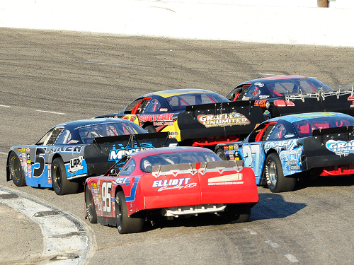 Lee Pulliam (5) leads a three-wide battle for the lead in the late stages of Saturday's IceBreaker at Myrtle Beach Speedway.